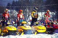 snowmobile, race, winter, Waitsfield, VT, Vermont, Drivers lined up with their snowmobiles to begin the Snowmobile Race at the Mad River Valley Winter Carnival in Waitsfield in winter.