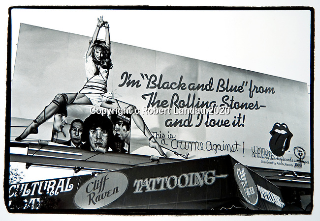 Rolling Stones billboard for record Black And Blue on theSunset Strip with grafitti