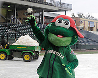 Greenville Drive mascot Reedy Rip'It throws a snowball after a game between the Furman Paladins and Northwestern Wildcats was stopped after five innings due to heavy snow on Saturday, February 16, 2013, in Greenville, South Carolina. After a 90-minute delay the game was cancelled. (Tom Priddy/Four Seam Images)