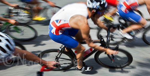 24 JUN 2012 - KITZBUEHEL, AUT - Competitors, including Stuart Hayes (GBR) of Great Britain (#46, in blue and white), on the bike during the elite men's 2012 World Triathlon Series round in Schwarzsee, Kitzbuehel, Austria (PHOTO (C) 2012 NIGEL FARROW)