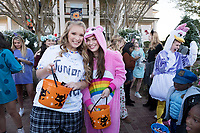 Hali Sills, left, a sophomore marketing major from Sikeston, Missouri, and Kara Gould, right, a sophomore management major from Keller, Texas, hand out candy during Trick-or-Treat on the Row, one of many Halloween festivities at MSU. <br />  (photo by Megan Bean / &copy; Mississippi State University)