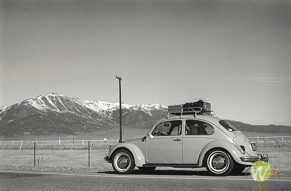 Central California, 1970. 1968 Volkswagon Beetle with luggage rack.