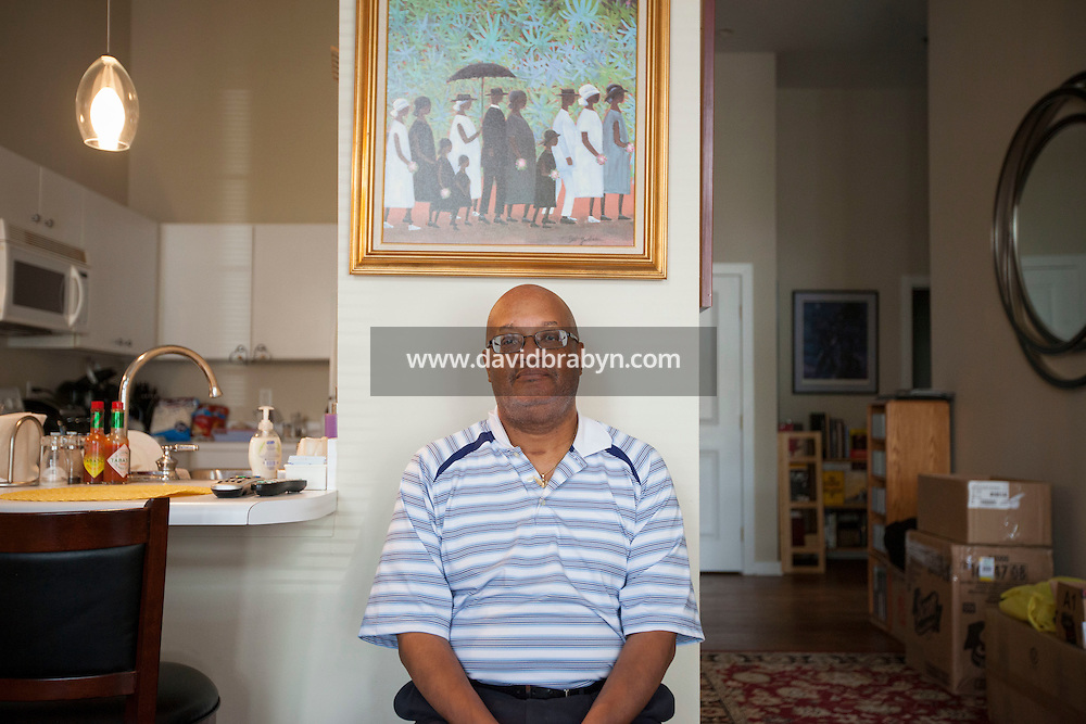 HSUL 20140820 United States, St Louis, MO. Reverend Earl E. Nance Jr poses for the photographer in his home in St Louis, MO, on August 20, 2014. Photographer: David Brabyn