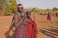 Mursi warrior with his  Kala?nikov rifle in Omo valley village Ethiopia