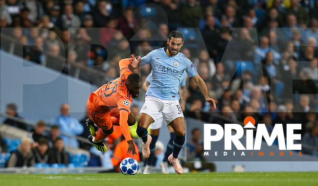 Ilkay GUNDOGON of Manchester City battles Tanguy NDOMBELE of Olympique Lyonnais during the UEFA Champions League match between Manchester City and Olympique Lyonnais at the Etihad Stadium, Manchester, England on 19 September 2018. Photo by David Horn / PRiME Media Images.