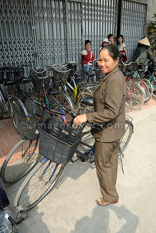 Asia, Vietnam, Tam Coc nr. Ninh Binh. Parking bicycles in guarded area.
