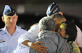 United States President Barack Obama descends Air Force One after touching down at Hickam Air Force Base in Honolulu, Hawaii on Wednesday, December 22, 2010.  The President embraces U.S. Senator Daniel Akaka (Democrat of Hawaii) and U.S. Representative Mazie Hirono (Democrat of Hawaii).  After a brief delay with matters in Washington, Obama finally starts his vacation. .Credit: Cory Lum / Pool via CNP