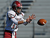 Glen Cove quarterback No. 12 Mike Payton takes a snap during the first quarter of the Nassau County varsity football Conference III final against Plainedge at Hofstra University on Saturday, Nov. 21, 2015.<br /> <br /> James Escher