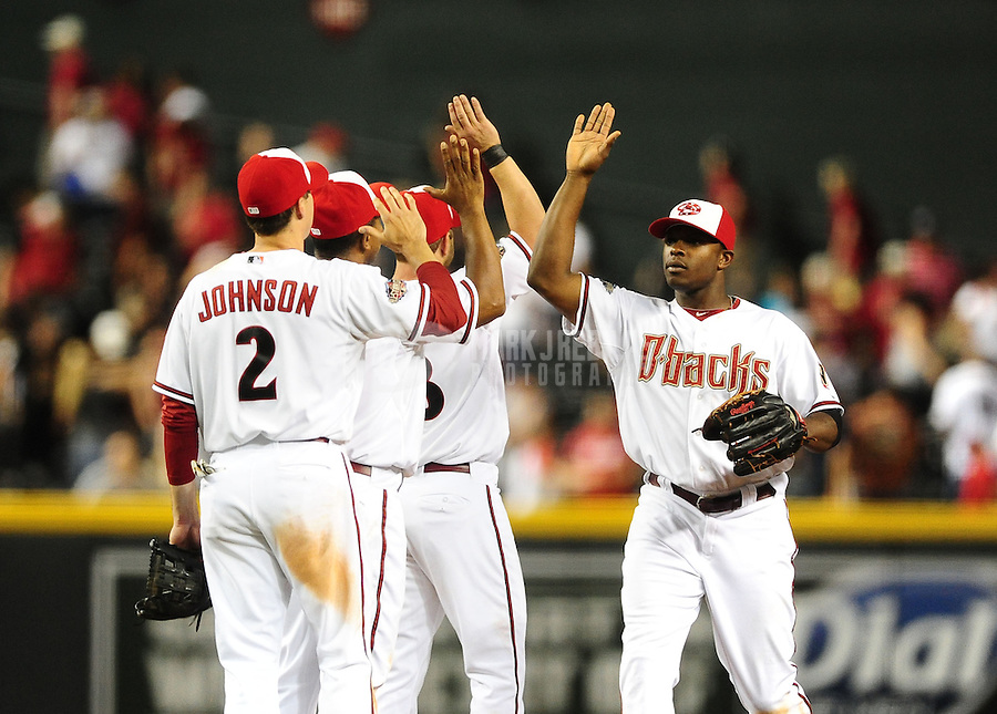 May 30, 2011; Phoenix, AZ, USA; Arizona Diamondbacks outfielder Justin Upton (right) and Kelly Johnson (left) celebrate with teammates following the game against the Florida Marlins at Chase Field. The Diamondbacks defeated the Marlins 15-4. Mandatory Credit: Mark J. Rebilas-