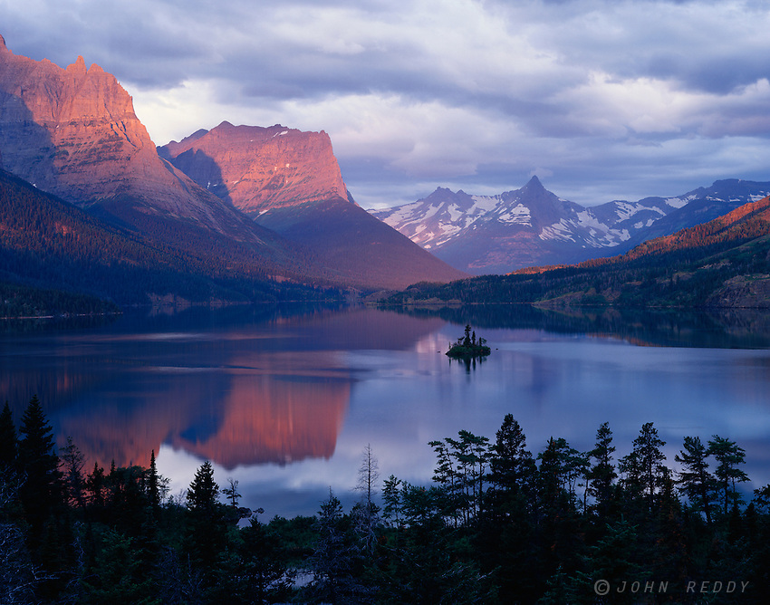 St. Mary Lake and Wild Goose Island at a serene sunrise with pastel colors