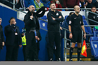 Manchester City manager Pep Guardiola takes his scarf off after protesting with the fourth official against a disallowed goal during the Fly Emirates FA Cup Fourth Round match between Cardiff City and Manchester City at the Cardiff City Stadium, Wales, UK. Sunday 28 January 2018