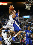 Air Force's Max Yon shoot past Nevada defender Deonte Burton during an NCAA basketball game in Reno, Nev., on Saturday, Feb. 1, 2014. (AP Photo/Cathleen Allison)