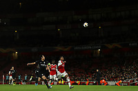 28th November 2019; Emirates Stadium, London, England; UEFA Europa League Football, Arsenal versus Frankfurt; Joe Willock of Arsenal competes for the ball with Makoto Hasebe of Eintracht Frankfurt - Editorial Use