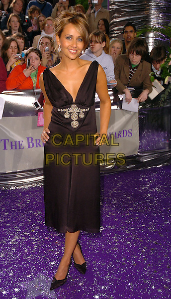SAMIA GHADIE SMITH.The Brtish Soap Awards - Arrivals,.BBC Television centre, London, .May 20th 2006..full length black dress hand on hip.Ref: CAN.www.capitalpictures.com.sales@capitalpictures.com.©Can Nguyen/Capital Pictures