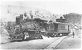 3/4 fireman's-side view of D&amp;RGW #318 with combine #215 viewed from the depot platform at Gato.<br /> D&amp;RGW  Gato (Pagosa Junction), CO  Taken by Moedinger, William - 1933