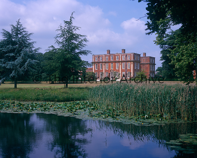 View of Chicheley Hall from across the lily pond in the park