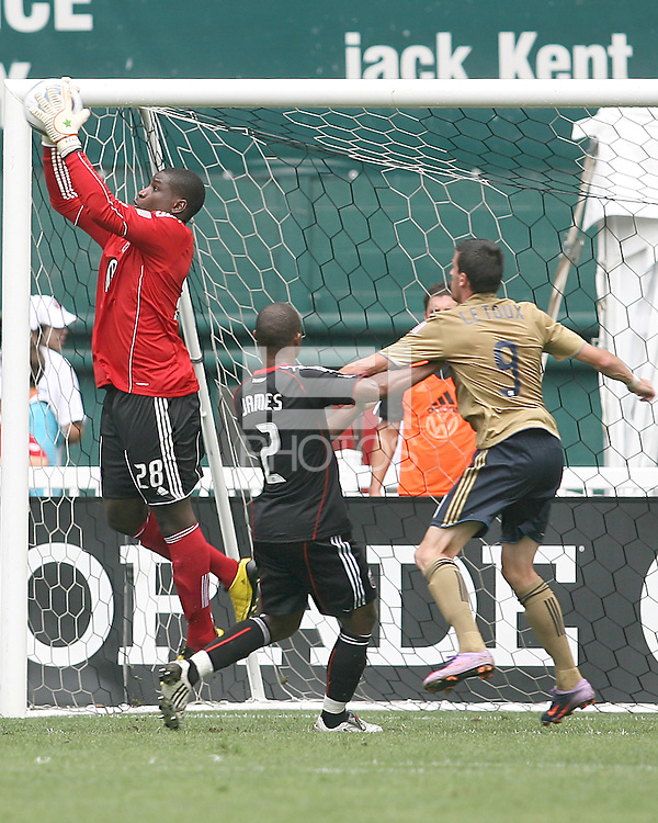 Bill Hamid #28 of D.C. United grabs the ball in front of Sebastien Le Toux #9 of the Philadelphia Union during an MLS match at RFK Stadium on August 22 2010, in Washington DC. United won 2-0.