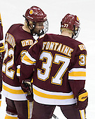 Mike Connolly (Duluth - 22), Justin Fontaine (Duluth - 37) - The University of Minnesota-Duluth Bulldogs defeated the University of Michigan Wolverines 3-2 (OT) to win the 2011 D1 National Championship on Saturday, April 9, 2011, at the Xcel Energy Center in St. Paul, Minnesota.