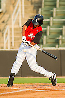 Keenyn Walker #2 of the Kannapolis Intimidators takes a swing at the baseball against the Asheville Tourists at Fieldcrest Cannon Stadium on July 28, 2011 in Kannapolis, North Carolina.  The Intimidators defeated the Tourists 2-1 in 10 innings.   (Brian Westerholt / Four Seam Images)