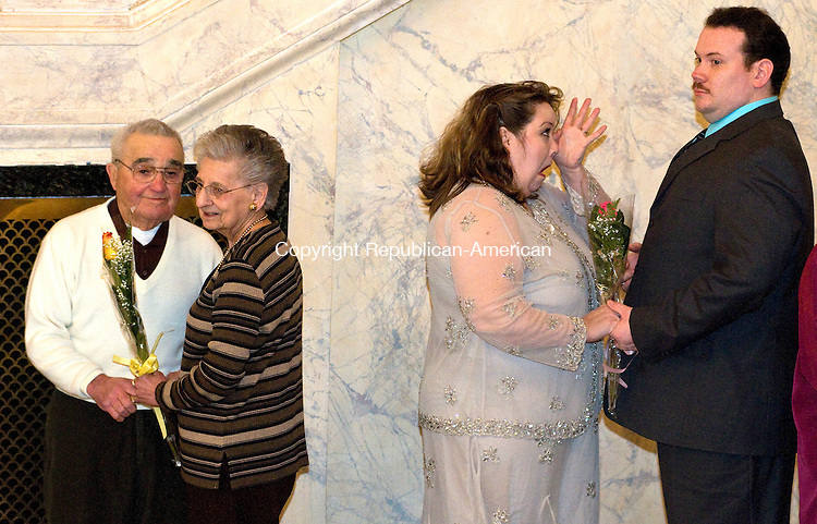 MIDDLEBURY, CT-022109JS03-Carol Crittendon of New Haven, second from right, wipes away a tear as she and her husband Steve Crittendon as well as Arthue and Margaret Paolucci of Wolcott, renew their wedding voes Saturday at the Palace Theatre in Waterbury. 13 area couples in all renewed their vows prior to the performance of the national tour of The Drowsy Chaperone. The Crittendon's have been married for 2 years and the Paolucci's have been married for 61 years. <br /> Jim Shannon  Republican-American