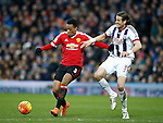 Anthony Martial of Manchester United tussles with Jonas Olsson of West Bromwich Albion - English Premier League - West Bromwich Albion vs Manchester Utd - The Hawthorns Stadium - West Bromwich - England - 6th March 2016 - Picture Simon Bellis/Sportimage