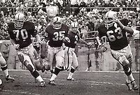 Oakland Raiders rush..#70 Jim Harvey leading Hewritt Dixon, Daryle Lamonica, and Gene Upshaw...(photo/Ron Riesterer)