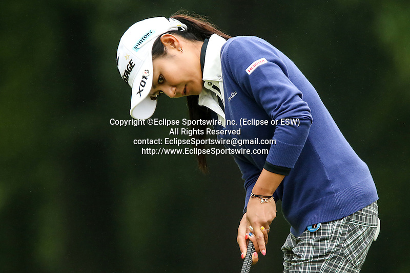 Japan's Ai Miyazato watches her putt on the fifth hole at the LPGA Championship at Locust Hill Country Club in Pittsford, NY on June 7, 2013