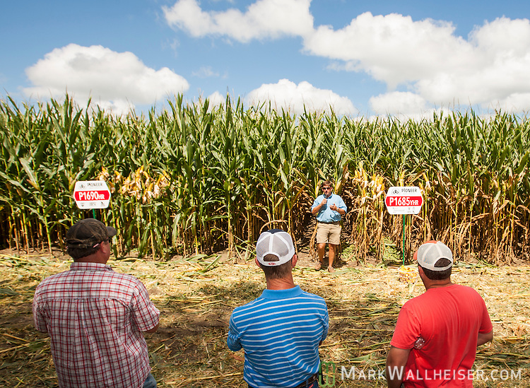 Kevin Phillips, a field agronomist in the southern business unit of the DuPont Pioneer company talks to attendees at the Farm Days event at Randy Dowdy's farm just outside of Pavo, Georgia July 17, 2013.  The group learned about Dowdy's crop yields, population surveys, hybrid corn and irrigation at the event sponsored by Pioneer of Dupont Pioneer.