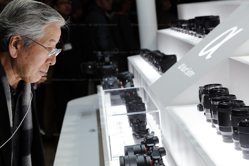 An old man looks at Sony digital cameras and lensa at the CP+ camera show in the Pacifico exhibition Hall, Yokohama, Kanagawa, Japan. Friday February 13th 2015