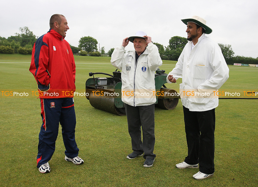 Umpires Inayat Kothia (right) and Ian Don discuss the prospects of play with Billericay CC groundsman Phil Jeggo. The match was subsequently abandoned - Billericay CC vs Epping CC - Essex Cricket League - 17/05/08 - MANDATORY CREDIT: Gavin Ellis/TGSPHOTO. Self-Billing applies where appropriate. NO UNPAID USE. Tel: 0845 094 6026