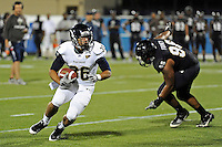 30 March 2012:  FIU's Lamarq Caldwell (36) carries the ball at the FIU Football Spring Game at University Park Stadium in Miami, Florida.