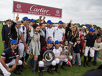 Thai Owned  King Power Foxes celebration pose following there win of the cup during the Cartier Queens Cup Final match between King Power Foxes and Dubai Polo Team at the Guards Polo Club, Smith's Lawn, Windsor, England on 14 June 2015. Photo by Andy Rowland.