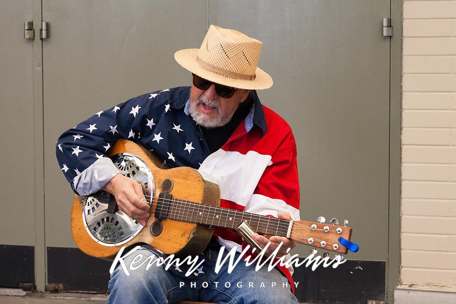Patriotic musician singing and playing guitar, Northwest Folklife Festival 2016, Seattle Center, Washington, USA.