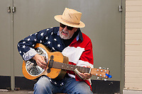 Patriotic musician singing and playing guitar, Northwest Folklife Festival 2016, Seattle Center, Washington, USA.