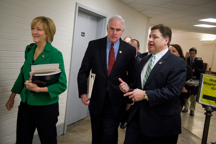 UNITED STATES - FEBRUARY 09:  Rep. Pat Meehan, R-Pa., center, walks with Rep. Betty Sutton, D-Ohio, and Rep. Bill Shuster, R-Pa., on his way to a House Homeland Security Committee hearing in Cannon Building.  (Photo By Tom Williams/Roll Call)