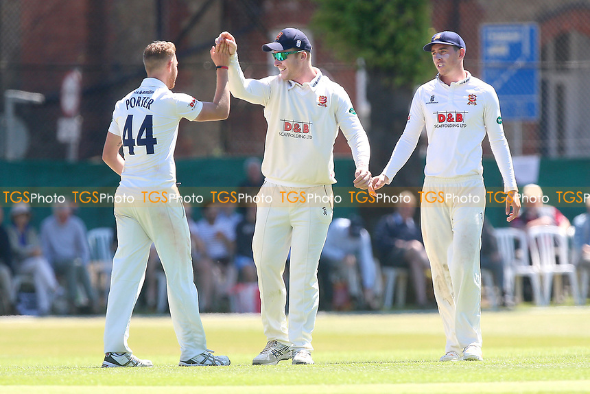 Jamie Porter of Essex is congratulated by his team mates after taking the wicket of Mark Footitt during Surrey CCC vs Essex CCC, Specsavers County Championship Division 1 Cricket at Guildford CC, The Sports Ground on 10th June 2017