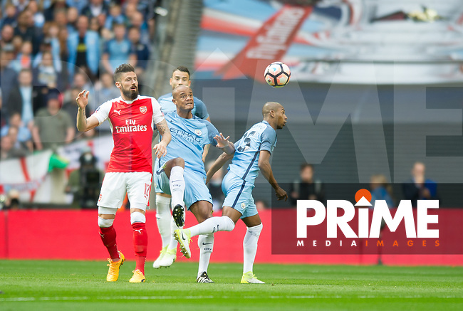 Manchester City Vincent Kompany and Arsenal's Olivier Giroud during the FA Cup Semi Final match between Manchester City and Arsenal at the Wembley  Stadium, Manchester, England on 23 April 2017. Photo by Andrew Aleksiejczuk / PRiME Media Images.
