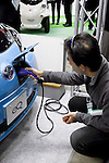 "December 13, 2012, Tokyo, Japan - A visitor connects the Toyota ""eQ"" car to the current electric. The Eco-Products Exhibition is one of the biggest environmental issues in Japan, drawing more than 180,000 business people and consumer exhibitors. The theme of this year is ""The Greener, The Smaller - The Future We Will Choose"", the exhibition will be held from December 13th to 15th in Tokyo Big Sight.(Photo by Rodrigo Reyes Marin/AFLO).."