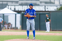 Team Italy relief pitcher Claudio Scotti (44) gets ready to deliver a pitch during an exhibition game against the Oakland Athletics at Lew Wolff Training Complex on October 3, 2018 in Mesa, Arizona. (Zachary Lucy/Four Seam Images)