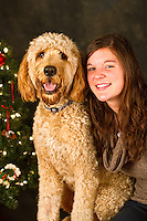 Griffy, a golden doodle, is photographed by Karen Ducey, with his owner Sara Kepa, at a Muttmixer holiday party thrown by City Dog magazine in Seattle, WA on December 09, 2010. (photo copyright Karen Ducey)
