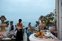 Guests of La Sponda restaurant enjoy the evening in Positano