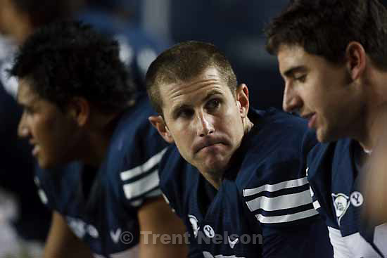 BYU's QB Max Hall (15) on the bench with the score 38-7. At left is BYU's RB Harvey Unga (45), right is BYU's TE Dennis Pitta (32).  BYU vs. TCU college football Saturday, October 24 2009 in Provo.