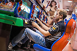 Triple world champion and Infiniti Red Bull Racing driver Sebastian Vettel (L) enjoy playing arcade games with a local girl at a game center in Shibuya district, central Tokyo on 09 October 2013 in Japan. Photo by Victor Fraile / The Power of Sport Images