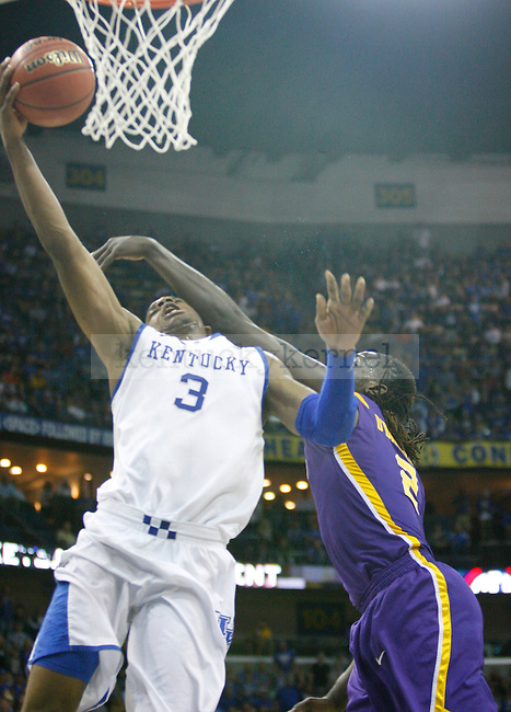 UK forward Terrence Jones is fouled by LSU's Johnny O'Bryant III during the second half in the 2012 SEC Tournament game between Kentucky and LSU, played at the New Orleans Arena, on 3/9/12.  Photo by Quianna Lige | Staff