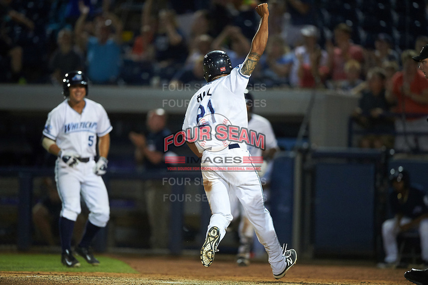 West Michigan Whitecaps Derek Hill (21) scores the game winning run during a game against the Burlington Bees on July 25, 2016 at Fifth Third Ballpark in Grand Rapids, Michigan.  West Michigan defeated Burlington 4-3.  (Mike Janes/Four Seam Images)