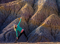 A woman stretches in a yoga pose at Clay Beds in Southern Utah