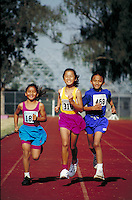 CAMBODIAN-AMERICAN TRACK RUNNERS TRAIN. CAMBODIAN-AMERICAN ATHLETES. LONG BEACH CALIFORNIA USA.