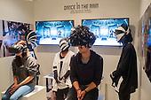 Watching music videos through a headset.  London Design Week, Truman Brewery, Brick Lane.