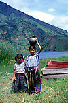 Two pretty Mayan Quiche girls by Lake Atitlan, Guatemala, central America,