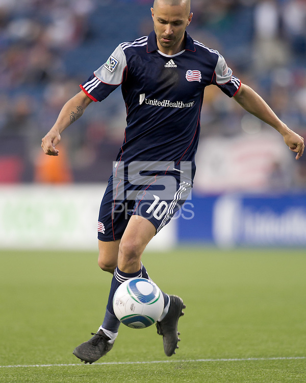 New England Revolution forward Rajko Lekic (10) traps the ball. In a Major League Soccer (MLS) match, the New England Revolution tied Toronto FC, 0-0, at Gillette Stadium on June 15, 2011.